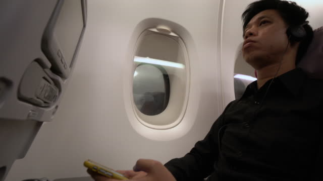 man using In-flight entertainment