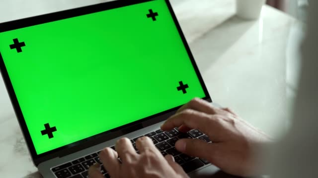 a man using laptop green screen on desk at home - shoulder stock videos & royalty-free footage