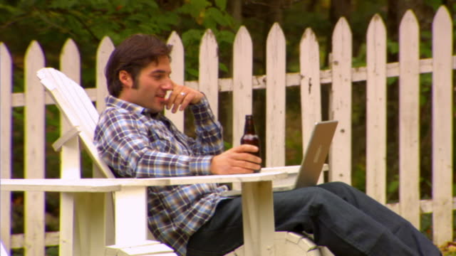 MS, Man using laptop in country house garden, Phoenicia, New York, USA