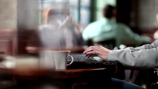 man using laptop in the restaurant. - using laptop stock videos & royalty-free footage