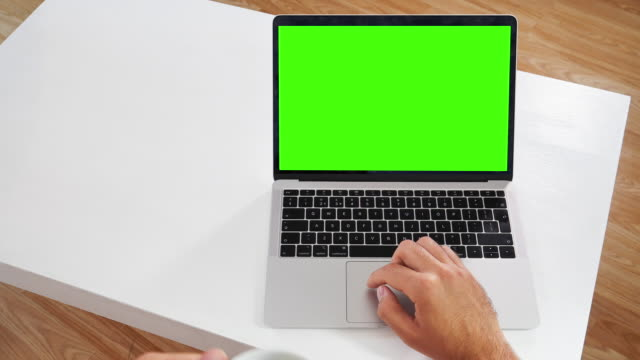 man using laptop: message display on green screen chroma key. - touchpad stock videos & royalty-free footage