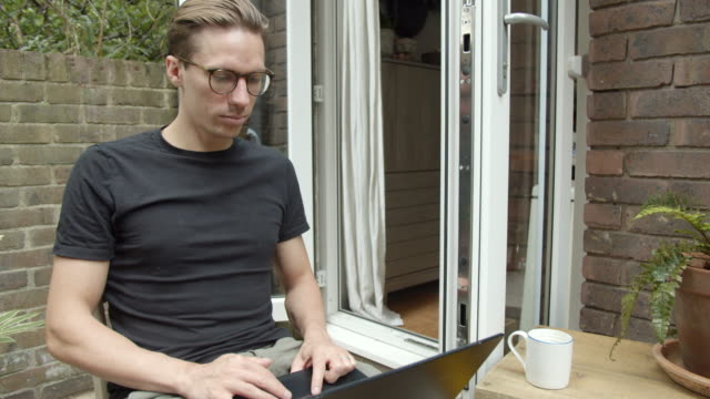 man using laptop outdoors - t shirt stock videos & royalty-free footage