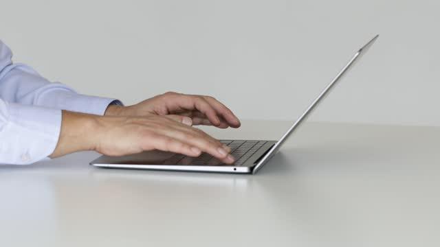 man using laptop - side view - enter key stock videos & royalty-free footage