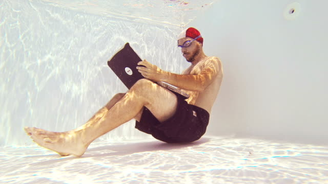 man using laptop underwater - sleep apnea stock videos and b-roll footage
