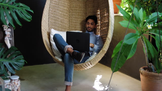 man using laptop - chair stock videos & royalty-free footage