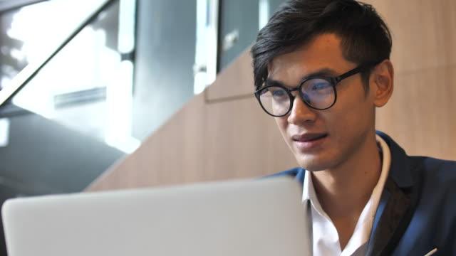 man using laptop - shirt stock videos & royalty-free footage