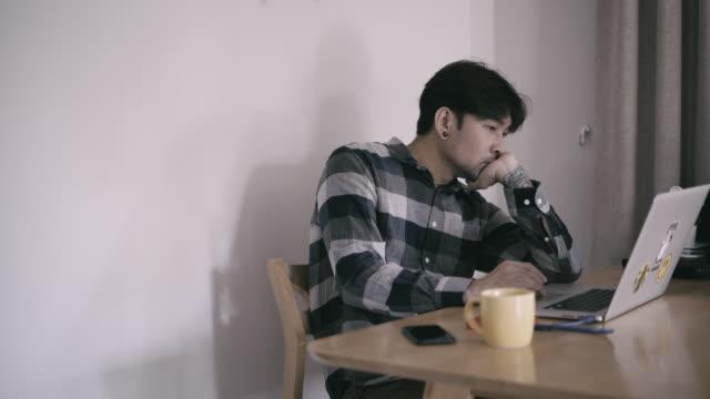 man using laptop working at home - hot desking stock videos & royalty-free footage