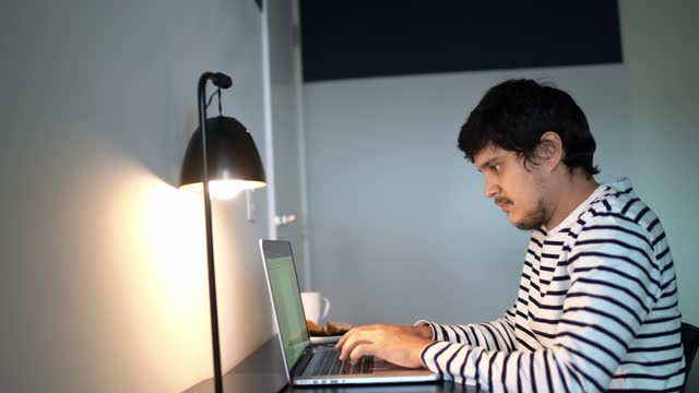 man using laptop working or studying at home - hot desking stock videos & royalty-free footage