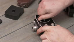 Man using miniature vintage 8mm film movie camera Winding and starting the motor