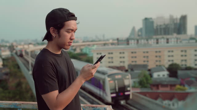 a man using mobile phone at rooftop - transportation building type of building stock videos & royalty-free footage