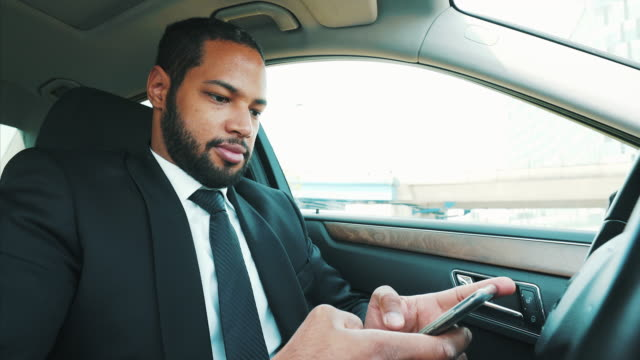 man using mobile phone in the car. - text messaging stock videos & royalty-free footage