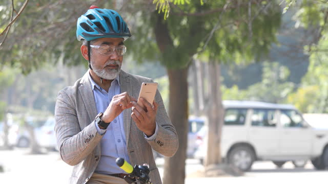 man using mobile phone on bicycle - one mature man only stock videos & royalty-free footage