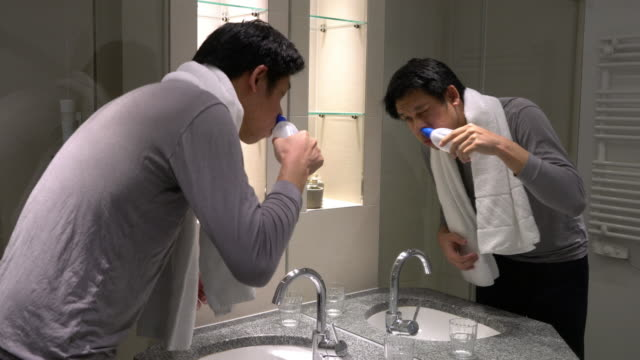 Man using Nasal Irrigation at home to prevent his chronic illness