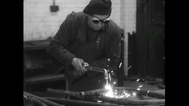 man using oxy-acetylene torch and men in workshop; 1956 - metal industry stock videos & royalty-free footage
