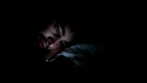 stockvideo's en b-roll-footage met man using phone at night, panning to alarm clock. - moe
