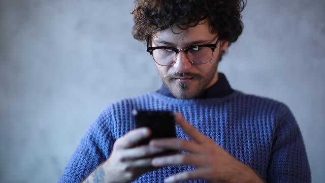 man using phone to send text messages - examining stock videos & royalty-free footage