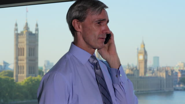 tu man using phone with westminster in distance - only mature men stock videos & royalty-free footage