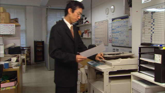 ms, man using photocopy machine in office - photocopier stock videos and b-roll footage