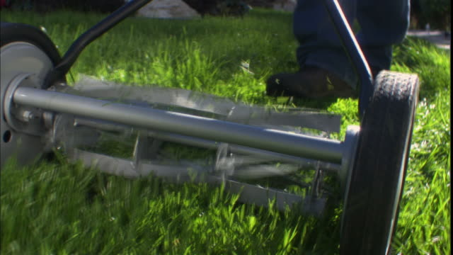 cu, man using rotary lawn mower, low section, california, usa - lawn mower stock videos and b-roll footage