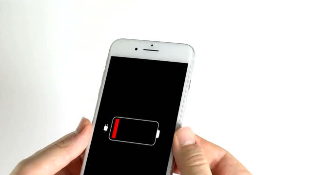 man using smart phone and charging - elettricità video stock e b–roll