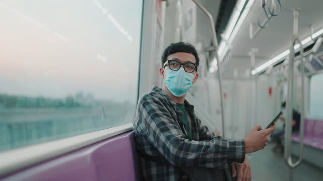 a man using smart phone and looking view on train - elevated train stock videos & royalty-free footage