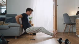 DS Man using smart phone for doing some exercises at home