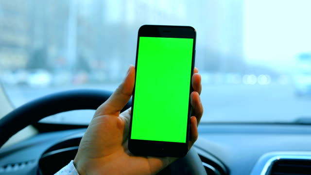 man using smart phone in car,green screen - danger stock videos & royalty-free footage