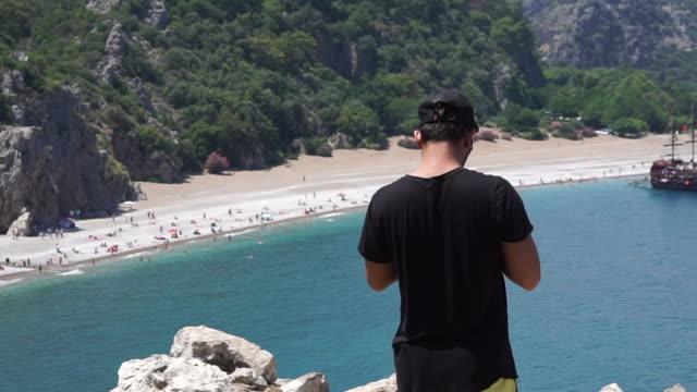 Man using smart phone in summer