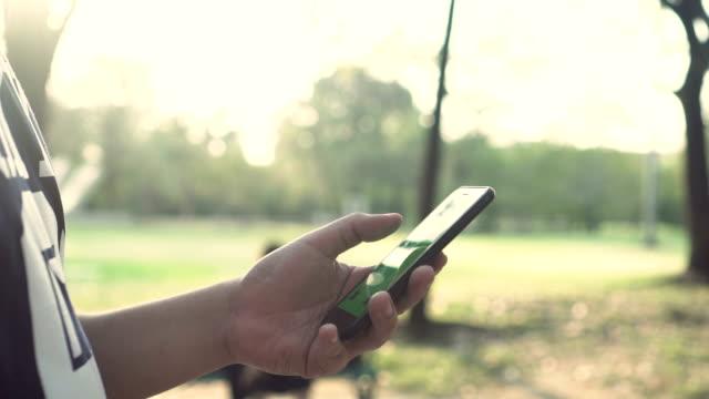 CU Man Using Smart Phone In The Garden