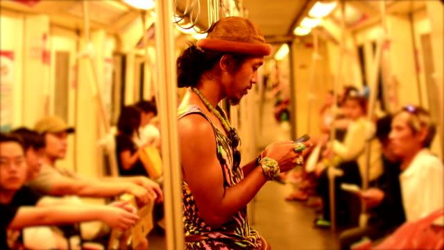 Man using Smart phone on train