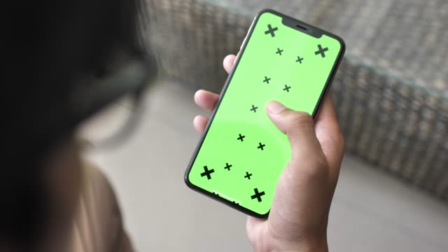 man using smart phone with green screen - scrolling stock videos & royalty-free footage