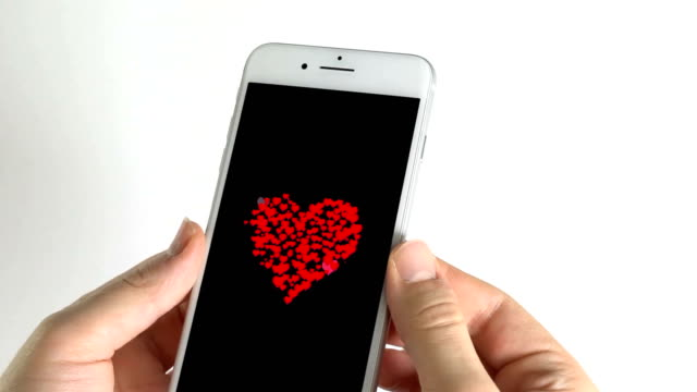 Man using smartphone and beating red hearts in the screen shape heart