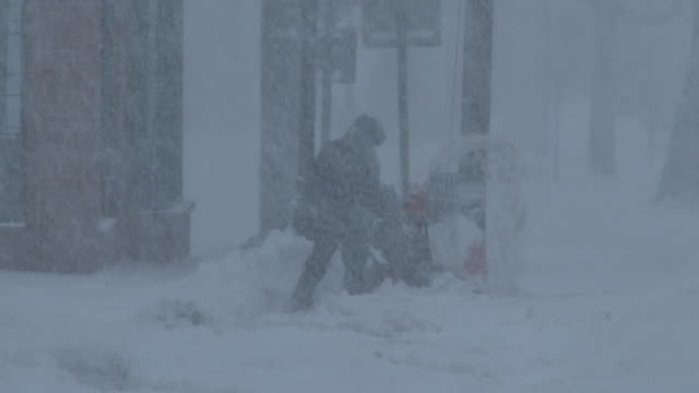 man using snowblower in extreme blizzard conditions, strong winds, whiteout - scott mcpartland stock videos & royalty-free footage