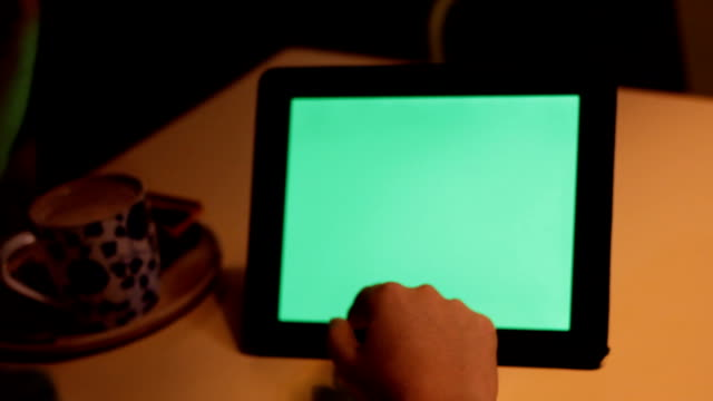 Man using Tablet in Coffee Shop green screen