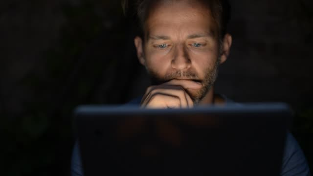 Man Using Tablet Pc aptop at Night