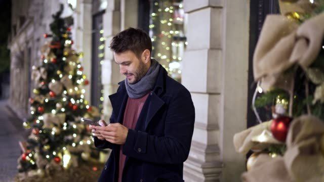 man using the mobile phone on christmas holidays - scarf stock videos & royalty-free footage