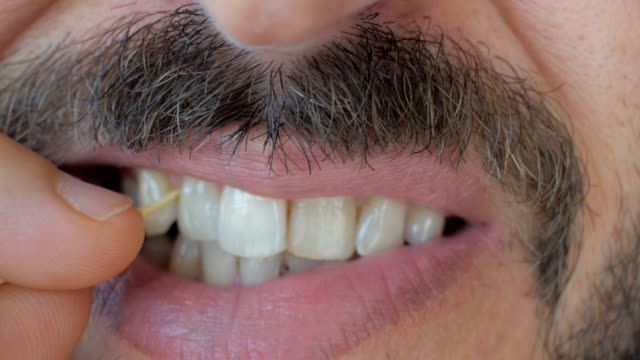 man using toothpick - moustache stock videos & royalty-free footage