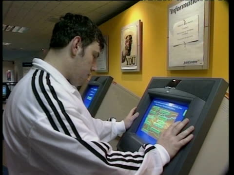 man using touch screen monitor at job centre part of labour 'new deal' initiative jan 98 - unemployment stock videos & royalty-free footage