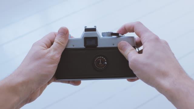 Man Using Vintage Camera POV