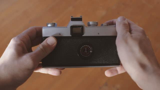 man using vintage camera pov - photographing stock videos & royalty-free footage