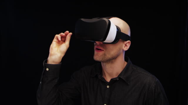 man using virtual reality glasses. aiming with dart - darts stock videos and b-roll footage