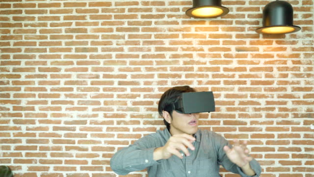 man using virtual reality headset - dolly shot stock videos & royalty-free footage