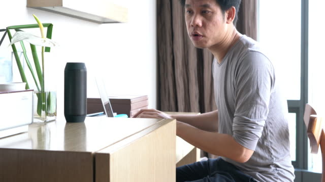 man using voice to command home appliance and equipment - assistant stock videos and b-roll footage
