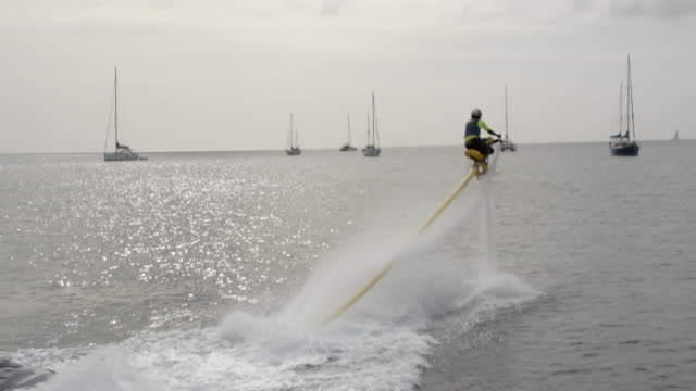 man using water jet pack / st lucia, caribbean - water sport stock videos and b-roll footage