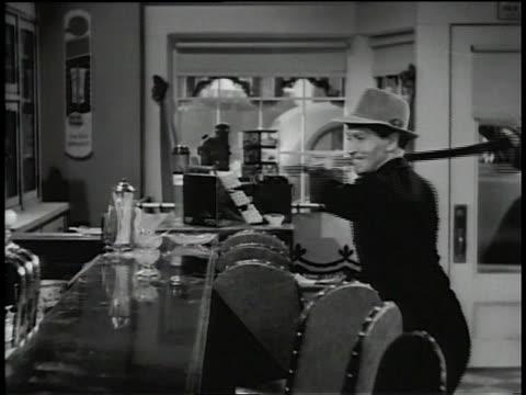 1945 ms a man vandalizes a bar with an ax - präsentation hinter glas stock-videos und b-roll-filmmaterial