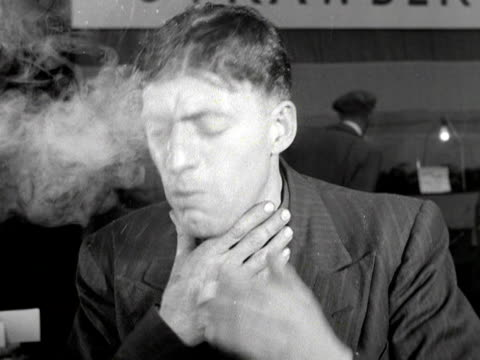 a man vigorously smokes a cigarette and then starts coughing - smoke physical structure stock videos & royalty-free footage