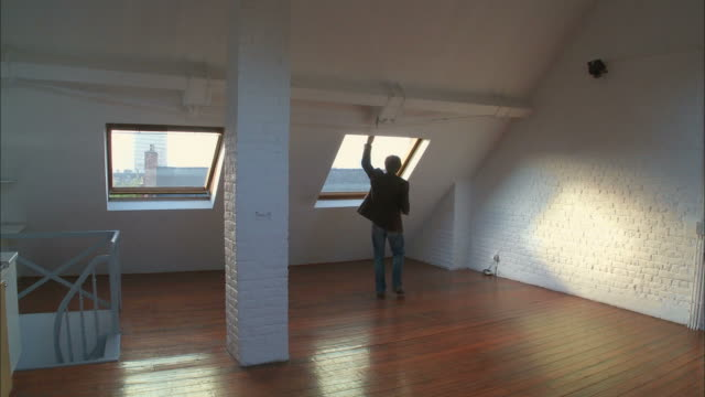 ws, man visiting empty attic apartment, brussels, belgium - attic stock videos and b-roll footage