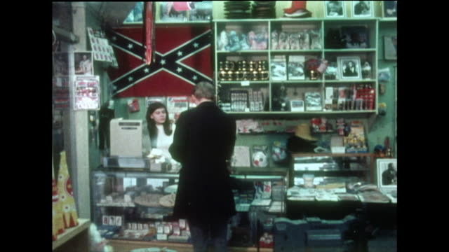 man visits a souvenir shop in washington d.c.; 1970 - confederate flag stock videos & royalty-free footage