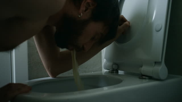 Man Vomiting In Bathroom