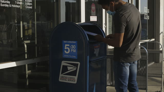 man voting at post office - correspondence stock videos & royalty-free footage